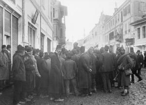 Local men gather to listen to a Serbian soldier © IWM (Q 52351)