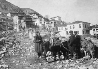 Local Residents with their pack mules © IWM Q86222