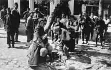 Locals draw water from a well in Skoplje © IWM (Q 86421)