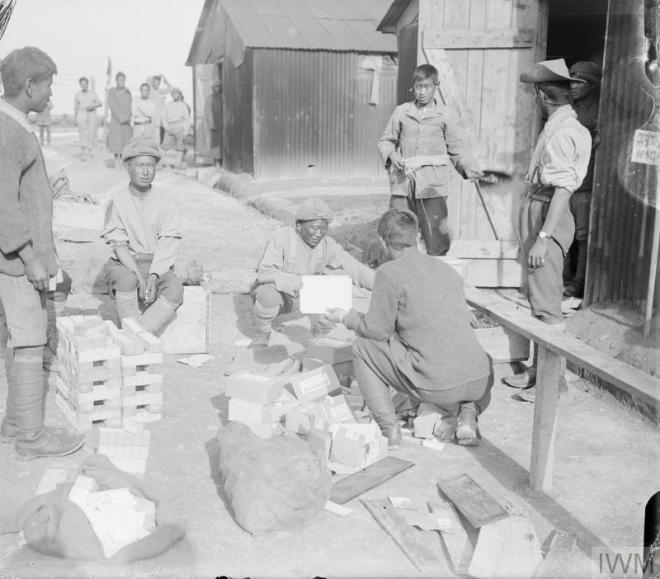 Manipur Labour Corps issuing soap and cigartettes in camp at Arras Oct 1917 IWM Q 6129